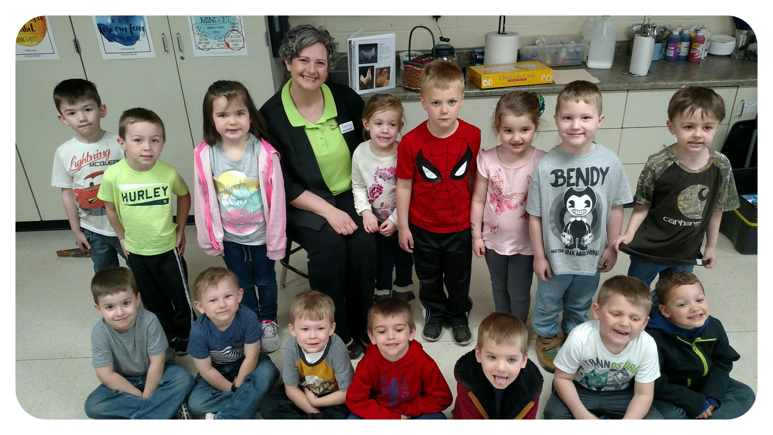 students with preschool smiling